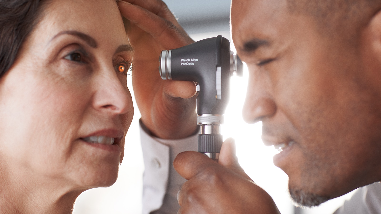 Welch Allyn PanOptic Plus Ophthalmoscope side view in application